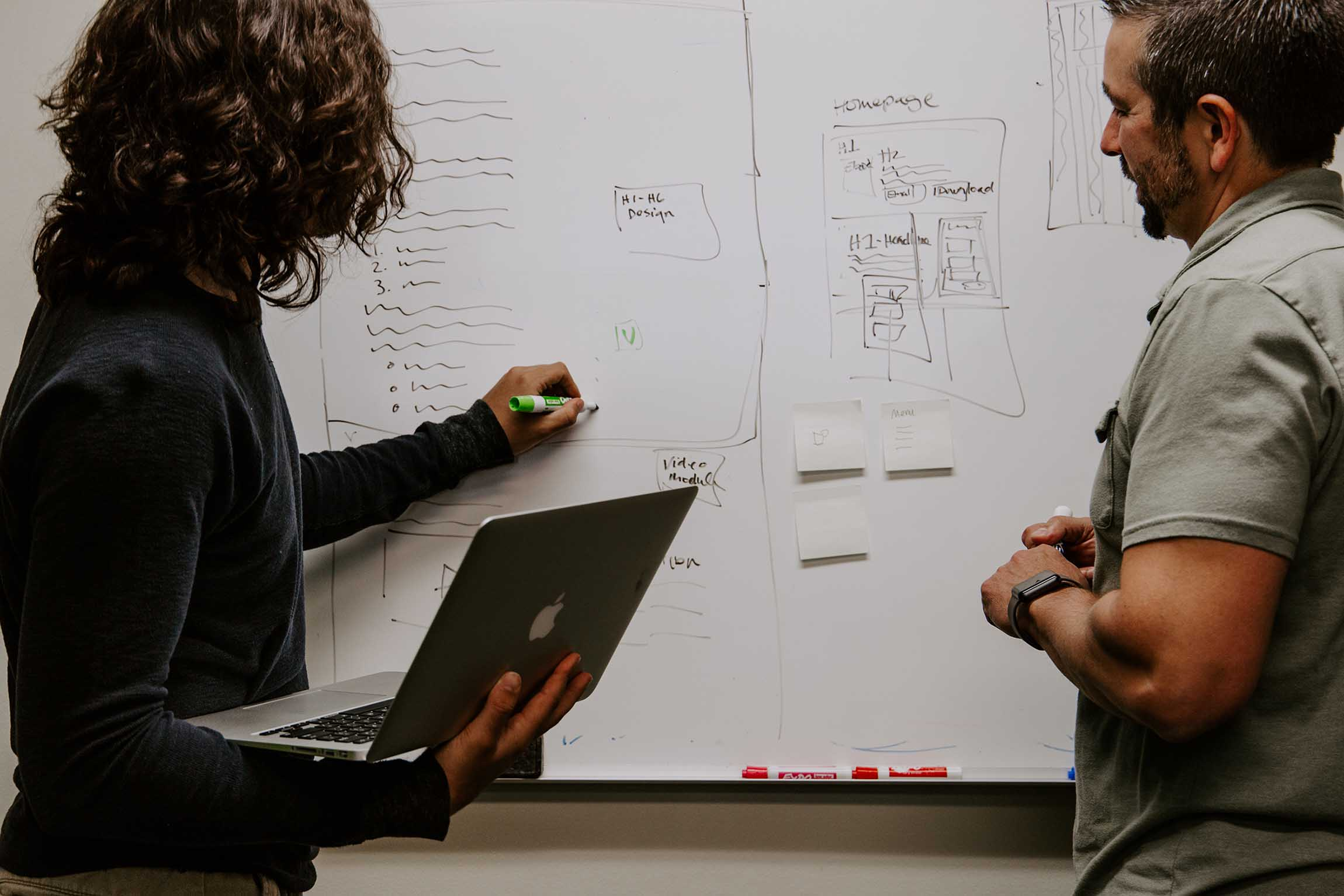 Two men planning on a drawing board